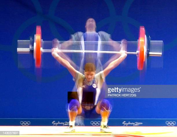 Time exposure shows Tarana Abbasova from Azerbaijan during the women's 53kg weightlifting event 18 September 2000 of the Sydney Olympic Games...
