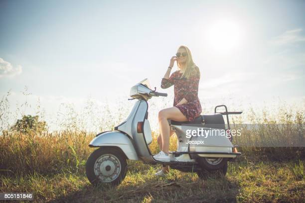 time for a call - moped stock photos and pictures