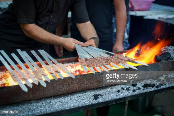 time for barbecue on street - muharram stock pictures, royalty-free photos & images