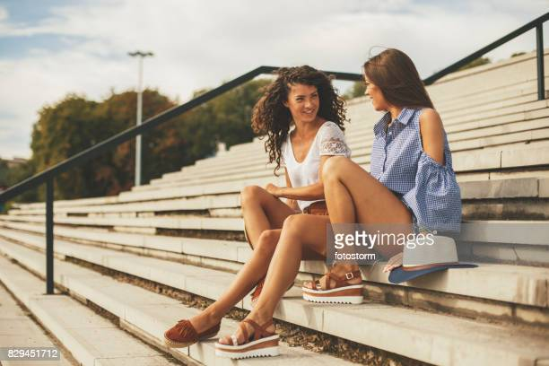 time for girlfriends' talk - sandal stock pictures, royalty-free photos & images