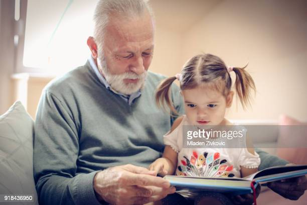 time for grandchild. - grandfather stock pictures, royalty-free photos & images