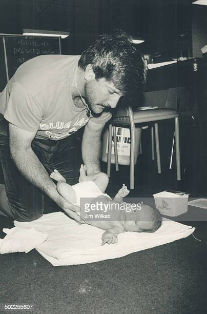 Time for necessary change One of Bill Caudill's final jobs around the Blue Jays clubhouse yesterday was changing son Cory's diapers The Jays packed...