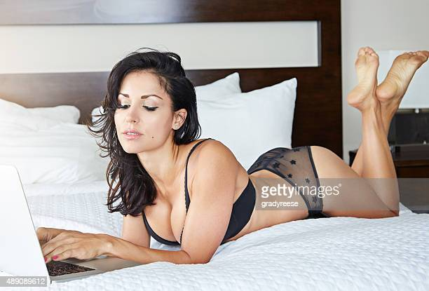 time for some online lingerie shopping - hot babe stock pictures, royalty-free photos & images