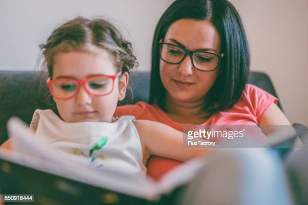 time for story - reading glasses stock pictures, royalty-free photos & images