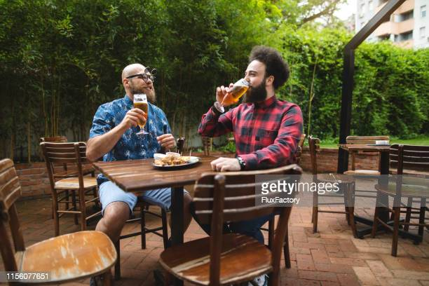 time for the beer with the best friend - best sunglasses for bald men stock pictures, royalty-free photos & images
