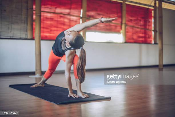 time for yoga training - yoga pants stock photos and pictures
