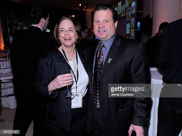 Time Inc Chairman and CEO Ann Moore poses with Olympic Gold Medalist Ice Hockey Player Mike Eruzione during the 2010 Sports Illustrated Sportsman of...