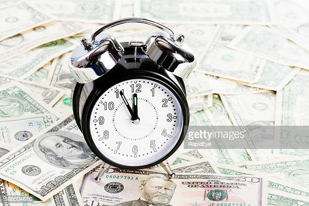 Time is money! Clock sits on pile of US currency