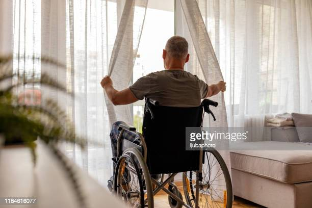 time is taking its toll on my aging body - wheelchair stock pictures, royalty-free photos & images