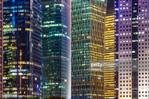 time lapse - skyscrapers in lujiazui financial district at night - hd format stock pictures, royalty-free photos & images