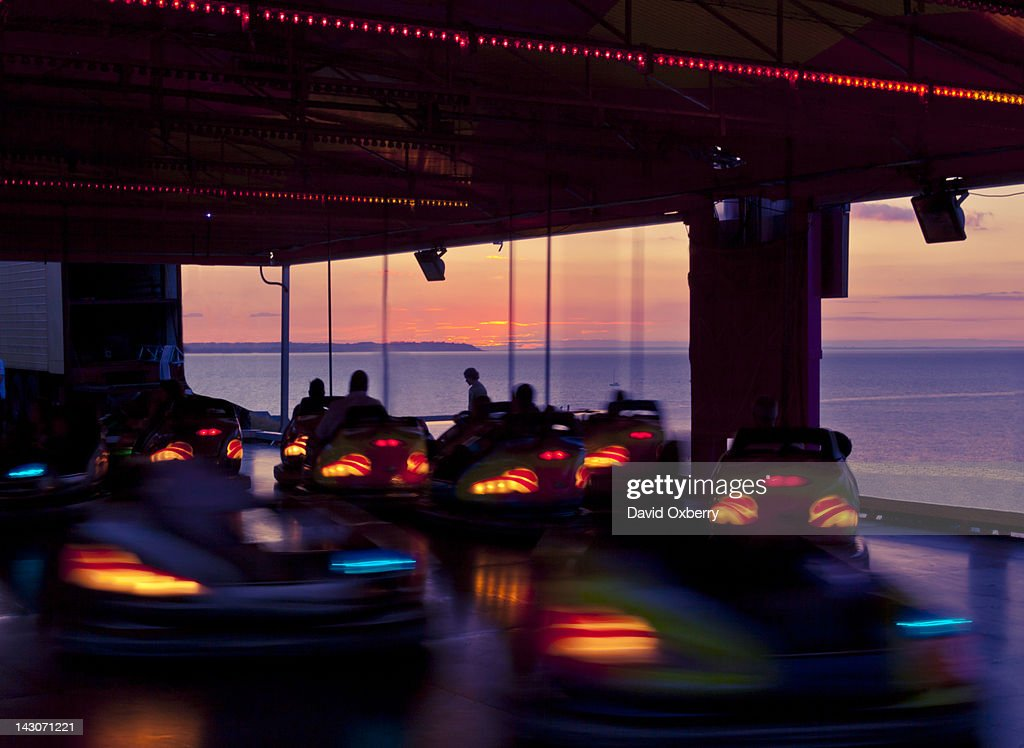 Time lapse view of bumper cars at sunset : Stock Photo