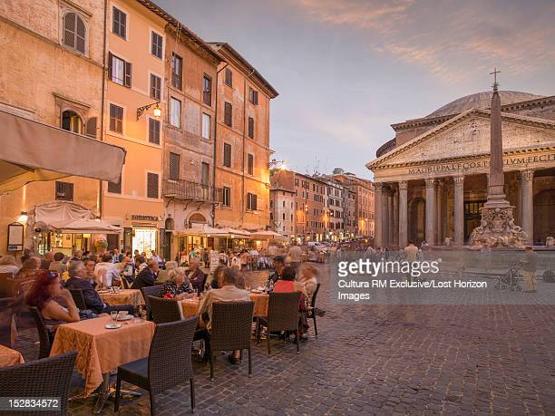 time lapse view of people in town square - pantheon rome stock photos and pictures