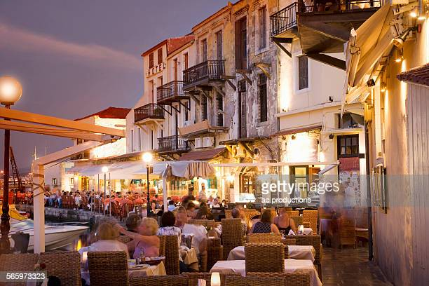 Time lapse view of sidewalk cafe at sunset, Mykonos, Cyclades, Greece