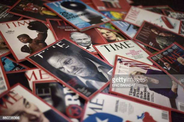 Time magazine copies are dispalyed on a table in Washgington on November 27 2017 Time Inc is selling for $28 billion to media conglomerate Meredith...