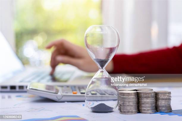 time management ideas invest ,money and hourglass,business concept - time stock pictures, royalty-free photos & images
