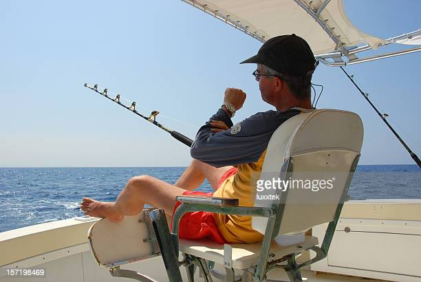 time management - big game fishing stock photos and pictures