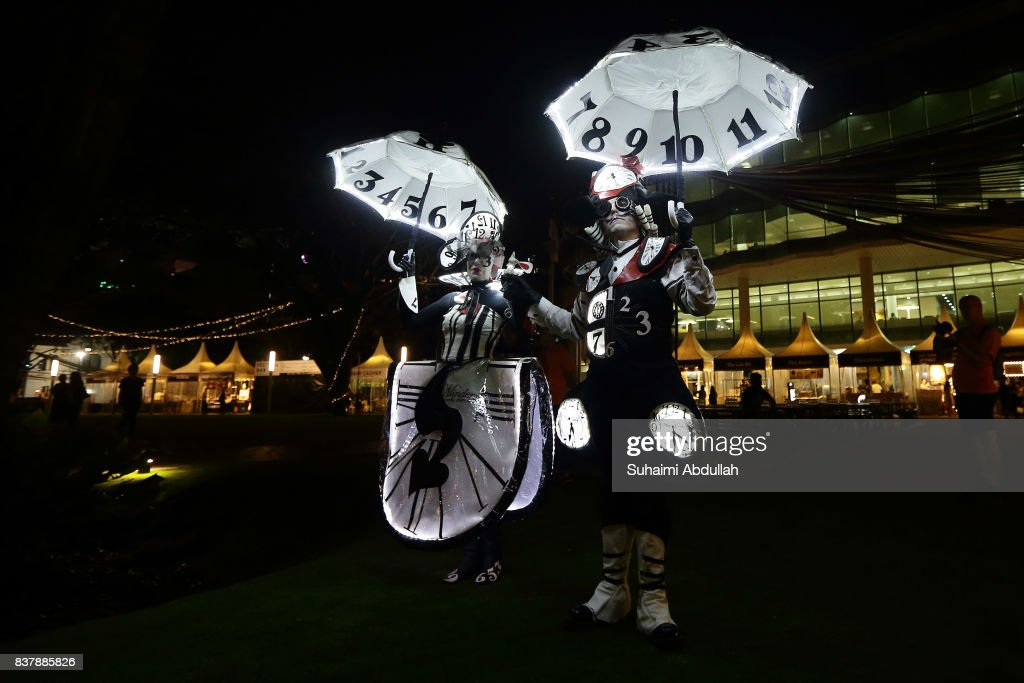 Time Minders by Galerie Mobile of Australia performs during the Singapore Night Festival media preview on August 23, 2017 in Singapore.