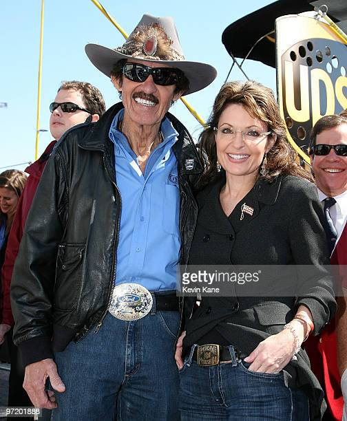 7 time NASCAR Champion Richard Petty and Former Alaska Governor Sarah Palin pose showing off their respective belt buckles prior to the Daytona 500...