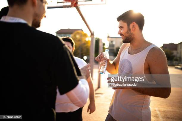time out for refreshment - basketball hoop stock pictures, royalty-free photos & images