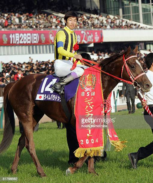 Time Paradox ridden by Japanese jockey Yutaka Take celebrates the victory during the Japan Cup Dirt on November 28, 2004 at Tokyo Race Course in...