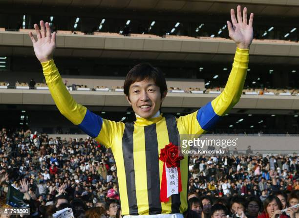 Time Paradox ridden by Japanese jockey Yutaka Take celebrates victory during the Japan Cup Dirt on November 28, 2004 at Tokyo Race Course in Fuchu,...