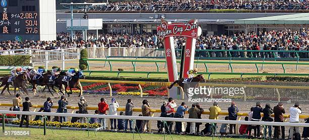 Time Paradox ridden by Japanese jockey Yutaka Take runs past the finishing post during the Japan Cup Dirt on November 28, 2004 at Tokyo Race Course...