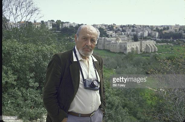 Time photographer David Rubinger standing on a hill with the Monastery of the Cross in the background