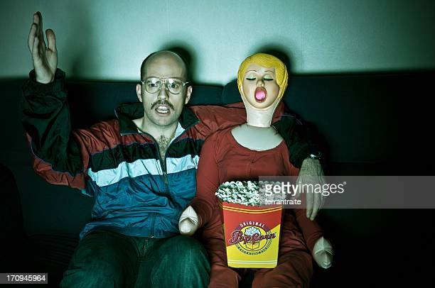tv time - blow up doll stock pictures, royalty-free photos & images