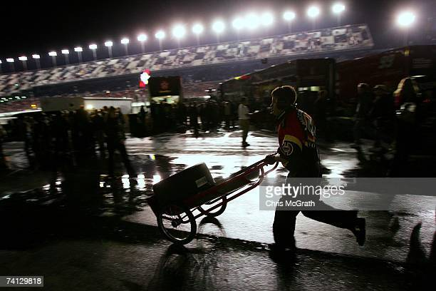 Time shot 719 pm A crew member hurriedly wheels a tire back to the team truck during the NASCAR Nextel Cup Series Daytona 500 at Daytona...
