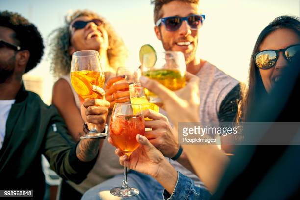 time spent having fun is time well spent - cocktail stock pictures, royalty-free photos & images