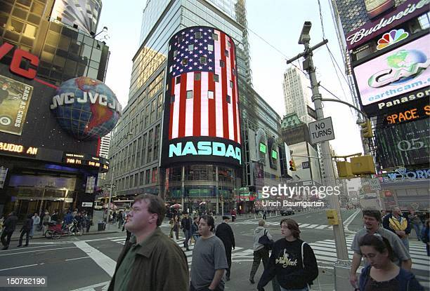 Time Square with NASDAQ display on whitch the American flag is shown