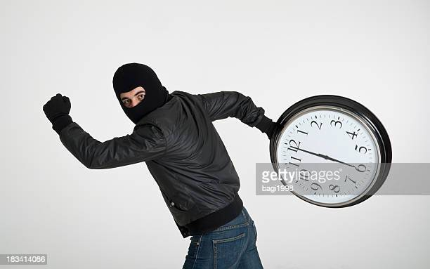 time thief - thief stock pictures, royalty-free photos & images