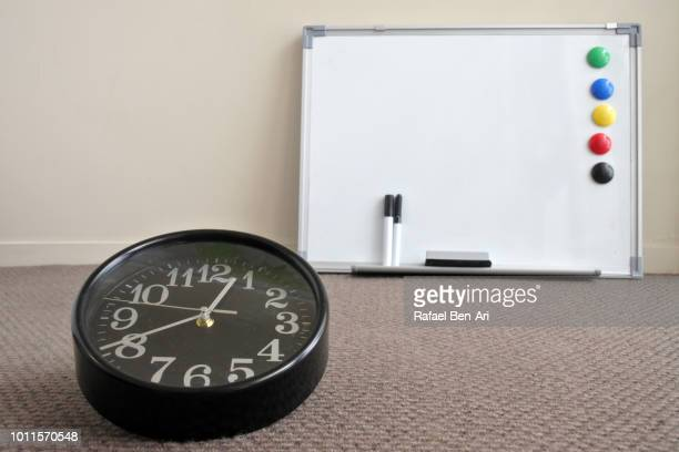 Time Ticking on Analog Clock and Clear Whiteboard