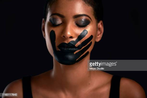 time to break the silence - protest against violence against women stock pictures, royalty-free photos & images