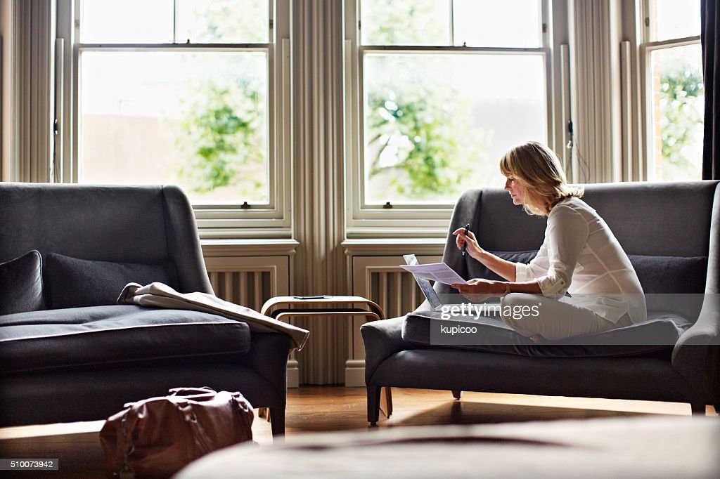 Time to catch up on her emails : Stock Photo
