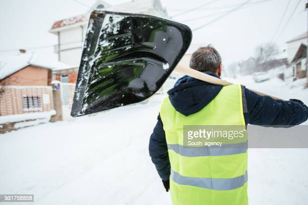 time to clean snow - snow shovel stock photos and pictures