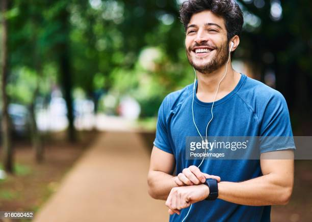 time to clock another personal best - brazilian men stock photos and pictures