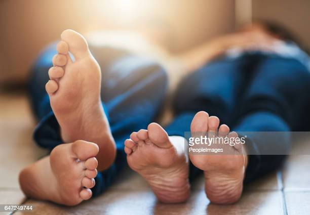 time to recharge - barefoot men stock photos and pictures