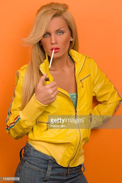 time to smoke - beautiful women smoking cigarettes stock photos and pictures