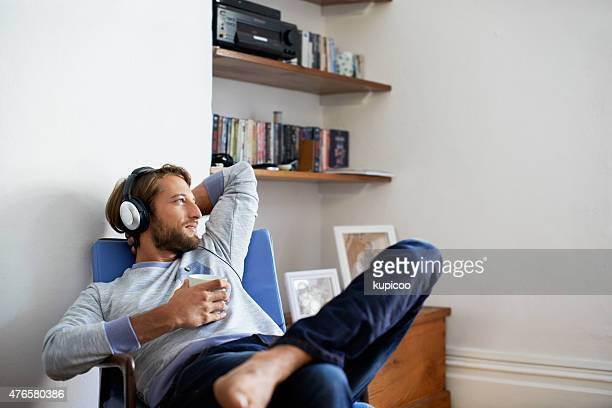 time to unwind with some music... - zorgeloos stockfoto's en -beelden