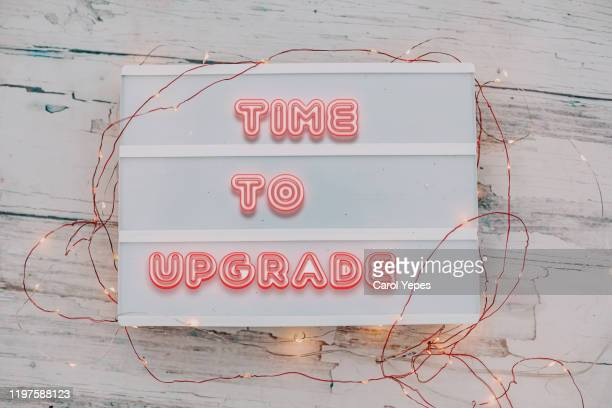 time to upgrade message in neon light - neuf photos et images de collection