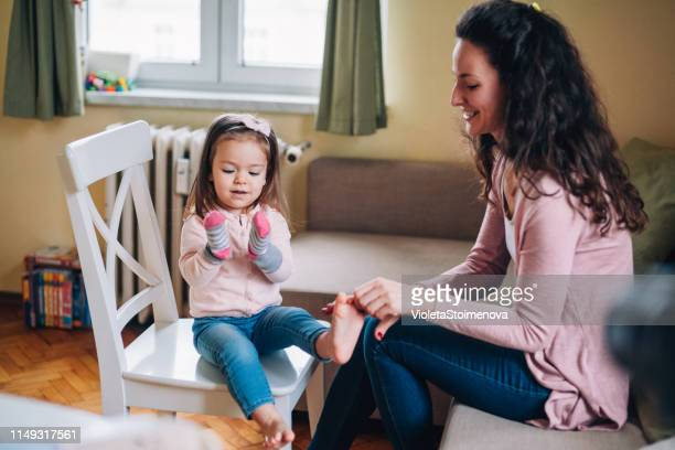 time together - pink sock image stock pictures, royalty-free photos & images