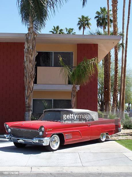 Time travel seems like a real possibility with this vintage 1960 Lincoln convertible resting in front of a mid-century modern apartment building in...