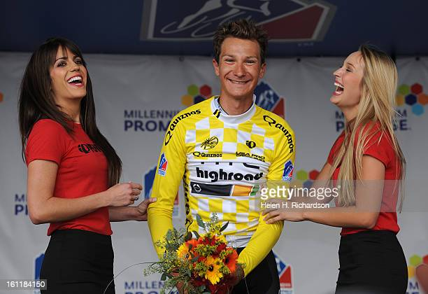 Time trial winner Patrick Gretsch of Team HTC Highroad stands on the podium and laughs after with the podium girls after receiving the yellow jersey...