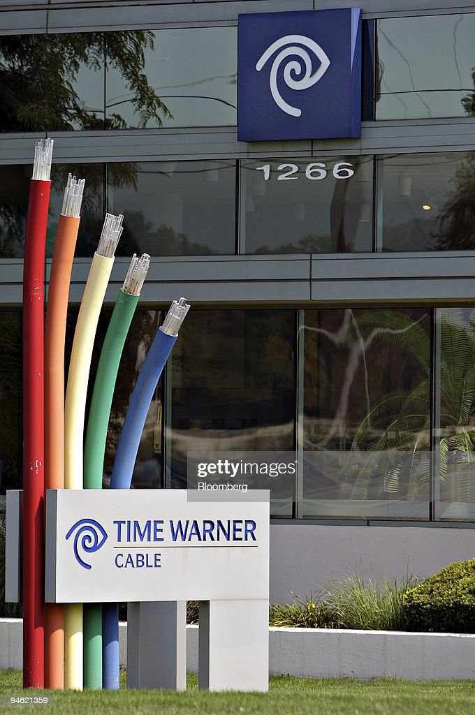 Time Warner Cable Logos Appear On Signs Outside The Company
