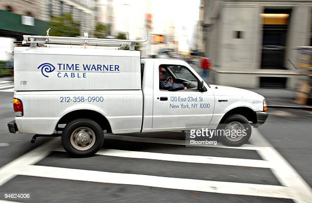 Time Warner Cable trucks turns a corner on a New York street Wednesday October 18 2006 Time Warner Inc's cable unit filed for an initial public...