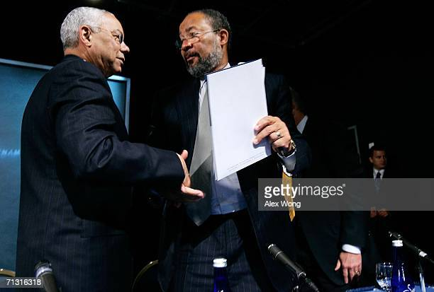 Time Warner Inc. Chairman & CEO Richard Parsons shakes hands with former Secretary of State Colin Powell after a news conference to announce the lead...