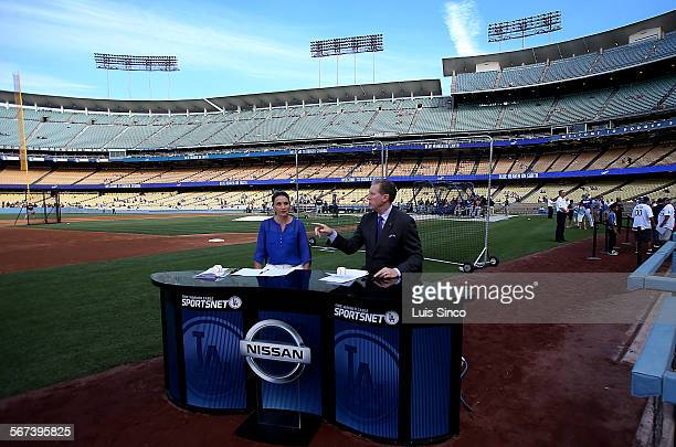 LOS ANGELES CALIF JULY 30 2014 Time Warner Sportsnet Dodgers commentators Alanna Rizzo left and Orel Hershiser do a pregame show befoe the game...
