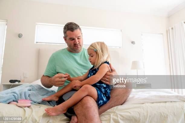 time with dad - child in bed clothed stock pictures, royalty-free photos & images