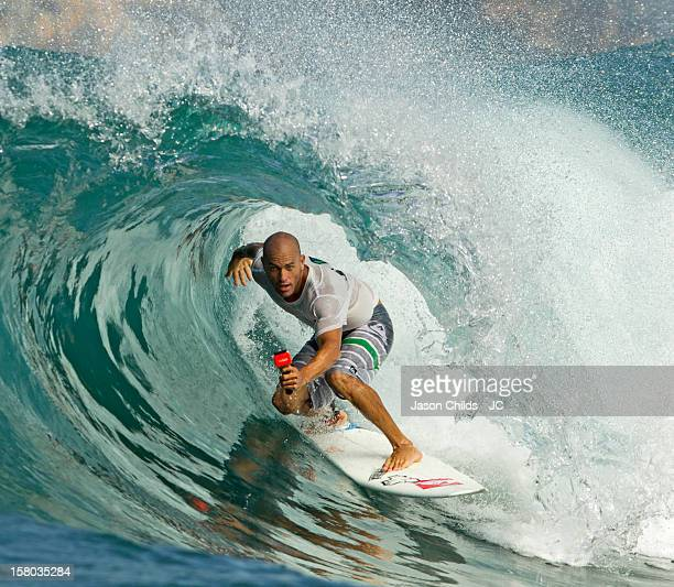 11 time World Surfing Champion Kelly Slater rides a wave while filming himself with his Go Pro Camera on April 28 2012 in Java Indonesia